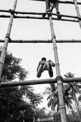 Indian Street - The In-complete Jump (Amartya Bhadra (on a break)) Tags: india lines streetphoto ruralindia charak ruralpeople indianstreetphoto