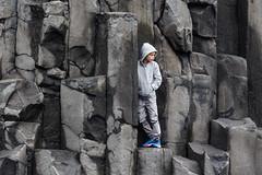 Contemplation (trochford) Tags: boy portrait rock canon person blacksand iceland hoodie exterior child outdoor candid vik column sweatshirt basalt reynisdrangar reynisfjall geoiceland