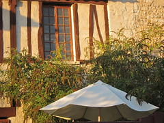 Normandie Sunset (Anna Sikorskiy) Tags: autumn sunset urban stilllife plants abstract france window colors beauty lines architecture umbrella canon garden europe artistic atmosphere naturallight historic walls normandy canonpowershots90