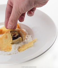Tarte tatin of fig with espuma of cantal cheese. (annick vanderschelden) Tags: baked baking bakingpaper butter cooking crisp crusty dessert espuma figs foam hand humanhand incision oven pack pointofview preparation pressure puffpastry seeds step stick sugar tartetatin three two whitekitchenboard whiteplate belgium