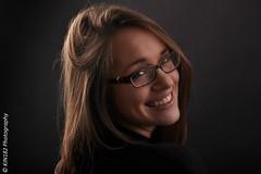 Alexandra (kin182photo) Tags: sourire smile dent face visage regard look fond noir low key clair obscur model modèle fille girl lunettes glasses gafas brille teeth kin182 portrait portraiture