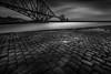 The Forth Rail Bridge (Billy Currie) Tags: forth rail bridge edinburgh lothian span iron train railway scotland cobbles jetty pier peir slippery river estuary crossing long exposure puddles mono black white light shade commuter route scotrail
