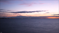Oresund Bridge (ArtDen82) Tags: sweden denmark malmö oresund bridge baltic sea sunset longexposure clouds