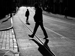 Walking (gianclaudio.curia) Tags: bianconero blackwhite controluce canong12 nottingham persone binari tram bwartaward