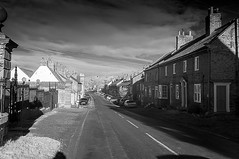 A North Yorkshire village. (johnhjic) Tags: johnhjic nikon d90 ir helperby northyorkshire building buildings village road car cars sky clouds lines line street yorkshire windows roof roofs door doors greatbritain blackwhite black white england english