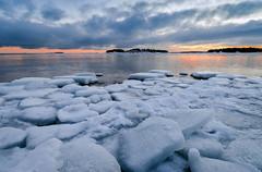 Ice Plates (tinamar789) Tags: ice sea seashore seascape sunset snow winter clouds cold reflection horizon lauttasaari helsinki finland