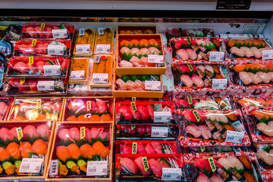 Variety of sushi packs at a market