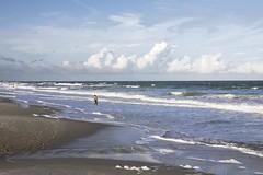 Shelling (G-daddyArt) Tags: ocean boy beach clouds landscape southcarolina cloudscape surfsidebeach