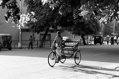 The Rickshaw Puller (vtuli77) Tags: street blackandwhite monochrome canon 50mm chandigarh scottkelby niftyfifty canon450d digitalrebelxsi canondigitalrebelxsi