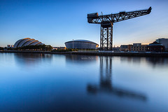 The Scottish Exhibition and Conference Centre (SECC) (baddoguy) Tags: uk longexposure morning blue industry horizontal architecture river outdoors photography scotland glasgow smooth copyspace clearsky alpenglow unusualangle 2015 clyderiver colorimage scottishexhibitionandconferencecentre architecturalfeature buildingexterior nationallandmark sunrisedawn craneconstructionmachinery businessfinanceandindustry