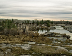 Grey Clouds over the Pinawa Dam (Explored) (creditflats) Tags: canada cold nature rock clouds pen river landscape concrete grey ruins frost dam olympus manitoba hydro channel pinawa hydroelectric whiteshell canadianshield m43 ep5 micro43