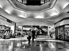 Window shopping at the mall (Dennis Sparks) Tags: blackwhite ontario london iphone westmontcentre mall windowshopping
