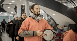 Abe Velazquez Plays a Drum During an Anti-Torture Demonstration at Union Station