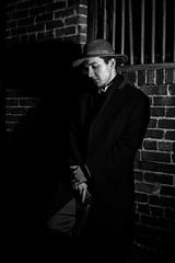 NOIR VIII (giladvalkor) Tags: noir suit hat blackandwhite bw monochrome alley 1940s 1950s darkphotography shadows night creepy scary man people portrait gun revolver silhouette contrast