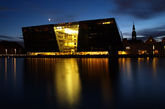 the black diamond..... (Snorri Thor) Tags: longexposure blue sky orange moon white house black water yellow architecture clouds reflections copenhagen stars denmark nightshot quality diamond zuiko danmrk kobenhavn kaupmannahfn zd 1445mm