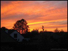 Sunset behind Diepholz (van heland) Tags: sunset red orange yellow clouds violet diepholz
