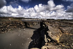 Bridge ... (asmundur) Tags: bridge america lava iceland europe cloudy artificial tourist stupid continent hdr attraction june2006 3exposures