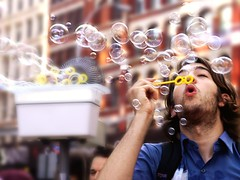 The Bubble Blower (Linus Gelber) Tags: nyc eastvillage newyork man guy bubbles blowing shades astorplace blowingbubbles lafayettestreet jasoneppink newmindspace bubblebattle