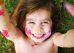 Paint Face ({amanda}) Tags: girl grass kids fun outside happy funny mess paint child play naturallight 30mm threeyears amandakeeysphotography