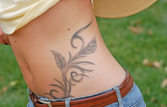 And this a a fantastic detail of her tattoo: wild wild west.