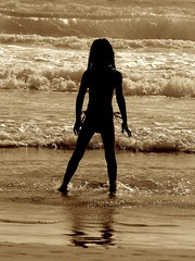 Angel in the morning (Earlette) Tags: ocean holiday beach beautiful silhouette sarah sepia kids swim children pretty waves natural swimmers tccomp072