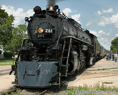 Number 261 (in La Crosse, Wisconsin) (Jim Frazier) Tags: old railroad black building history classic industry station june metal wisconsin train vanishingpoint shiny commerce power calendar v100 antique tracks machine engineering rail railway roadtrip 2006 heavymetal f10 historic equipment business machinery railwaystation amtrak trainstation depot historical americana g2 locomotive ctp f3 g3 lacrosse powerful f5 f25 steamengine apparatus 261 steamtrains traindepot f15 railroadstation v200 alco passengertrain v500 q5 v1000 milwaukeeroad v5000 v2000 explored interestingness334 threequarterangle lacrosse261 v4000 jun2006milwaukeeroad261 lacrossetrains projecttrainfromeachstate printed8x10ok jimfraziercom jfpblog wmembed