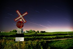 Meteors Crossing at Own Risk (Star Trails) (Gregory Pleau) Tags: sky signs ontario canada topf25 field night danger cn warning geotagged shower nikon crossing geocaching farm photoshopped d70s railway petersburg kitchener waterloo stop stopsign geocache farms starts meteor startrails railwaycrossing starlight cnrail highspeedtrains meteorshower perseids interestingness384 i500 24hourgeocachingmarathon explore15aug2006 firstofmyphotostohit500views gregorypleau