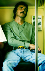 Even Batman sleeps on the train (Cultkid) Tags: toronto digital lomo crossprocessed go xprocessed fauxmo gotransit erindale thexenon