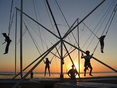 Jump in the sunset, Chatelaillon Plage coucher de soleil (* Thierry *) Tags: ocean sunset summer vacation orange sun mer beach sport jumping silhouettes 2006 f2 plage v50 charente chatelaillon views50 2faves theudric faves2