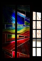 Window through the window (Christine Lebrasseur) Tags: blue red black france green art window glass yellow architecture canon rainbow exposure artist stained ventanas master craftsman cristal arco basquecountry artista manufacturer onblack pasvasco exposicin vitraux artesano worksofart bastida fabricante interestingness199 obrasdearte labastideclairence tccomp084 allrightsreservedchristinelebrasseur