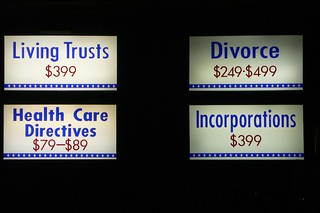 Sign advertising legal services: LIVING TRUSTS...