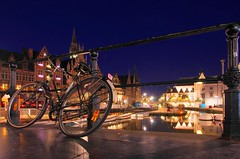 Graslei by night (sfryers) Tags: longexposure bridge summer reflection tower clock water bike bicycle architecture boats lights canal belgium traditional 14 tripod historic limited smc flemish railings ghent gent 15mm gorillapod pentaxda