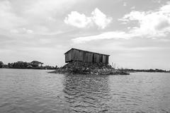 Beauty of Bangladesh (Rajib Mohiuddin) Tags: summer sky bw house water canon river blackwhite floating sunny sylhet bangladesh 600d