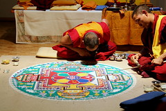 sand mandala (Etching Stone) Tags: life china wood west art geometric composition blessings flow death three sketch sand meditate floor image path robe south north craft compassion monk buddhism indoor center palace tibet east mind change balance karma wisdom enlightenment humanrights healing dharma brass karlsruhe liberation sweep tool beings bardo deities refuge individual serve animalright  construct guiding mandalas dimensional purification completion sentient schlachthof avalokiteshvara chenresig consecrated reside embody tollhaus