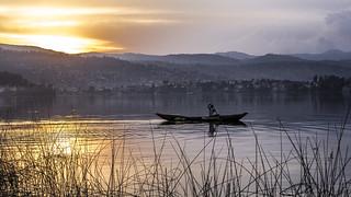Fisherman in his boat during the sunset at Lake Kivu, Bukavu, Democratic Republic of Congo