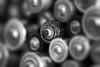 Battery. (Dikke Biggie.) Tags: hmm macromondays inspiredbyasong battery batteries batterij batterijen 52in2017 44round round rond blackandwhite bw black white zwartwit zw zwart wit monochrome monochroom dof depthoffield scherptediepte bokeh canon canoneos450d 100mm f28 closeup detail macro canonnl dgawc