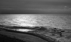 Ice Mounds (mswan777) Tags: monochrome ansel bw black white scenic seascape lake michigan reflection ice water waves stevensville sand beach outdoor nature great lakes nikon d5100 sigma 70300mm landscape sunlight cloud sky frozen
