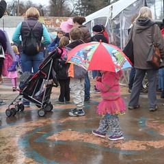 Rally in Cville (davekrovetz) Tags: pink love hope color fuji virginia charlottesville rally child umbrella portrait