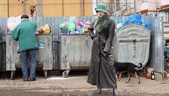 Green Leather (Russia) (Alaya Al-Chalifa) Tags: leather longcoat woman trash city street garbage