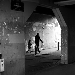 By running behind (pascalcolin1) Tags: paris homme man enfant child arche ombre shadow lumière light running photoderue streetview urbanarte noiretblanc blackandwhite photopascalcolin square