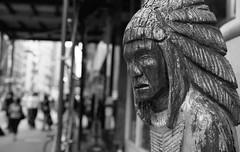 Chief Woodenhead (adrianmojica) Tags: street city nyc newyorkcity summer urban blackandwhite bw usa ny newyork film monochrome canon photography photo day unitedstates photos ae1 manhattan monochromatic canonae1 ilford lowermanhattan ilforddelta100 canonfd ilfordbw