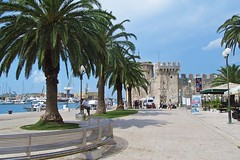 welcome to Trogir! :) (green_lover (your COMMENTS are welcome!)) Tags: trogir croatia fortress town palms trees sea architecture travels pavement walkway