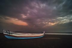 Bhuigaon Beach (Gladson777) Tags: sunset cloud sun india seascape beach colors season landscape boat twilight long time dusk vibrant sony rainy monsoon maharashtra thane 1855 alpha mumbai streaks slt a58 55200 vasai bhuigaon