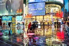 Rain Reflections at Times Square (Lojones13) Tags: newyorkcity reflection rain silhouette timessquare unbrella