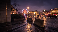 A l'cart de la fte... (Away From The Lights) (Gilderic Photography) Tags: christmas street city rain wheel silhouette lumix lights belgium belgique belgie market pluie panasonic lumiere rue liege ville roue gilderic lx3 dmclx3