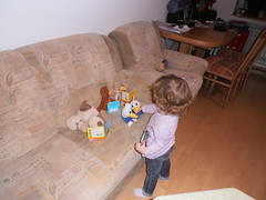 Reading Class (traveling peter) Tags: dog playing girl standing ball germany hair munich table toys bavaria reading monkey book back chair europe december sitting floor pants daughter teacher livingroom couch container indoors jeans stuffedanimals dolly armchair sophia myapartment lu tupperware laminate 2015 sendling obersendling year2015