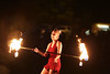 Fire and Laughter (kirstiecat) Tags: fire chicago woman female smile happiness firethrower firedancer dancer night canon street happy