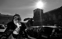 Always the right time for ice cream. (Baz 120) Tags: candid candidstreet candidportrait city candidface candidphotography contrast street streetphoto streetcandid streetphotography streetphotograph streetportrait rome roma romepeople romestreets romecandid europe women monochrome monotone mono blackandwhite bw noiretblanc urban voightlander12mmasph life leicam8 leica primelens portrait people unposed italy italia girl grittystreetphotography flashstreetphotography flash faces decisivemoment strangers