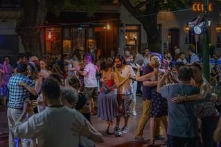 People dancing tango in the street.