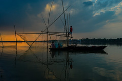 Fishing during golden time! (ashik mahmud 1847) Tags: bangladesh d5100 nikkor sky goldenhour river color light boat people fishing ngc